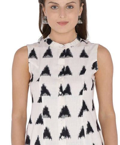 Sleeveless black and white double ikat cotton dress with embroidered pockets