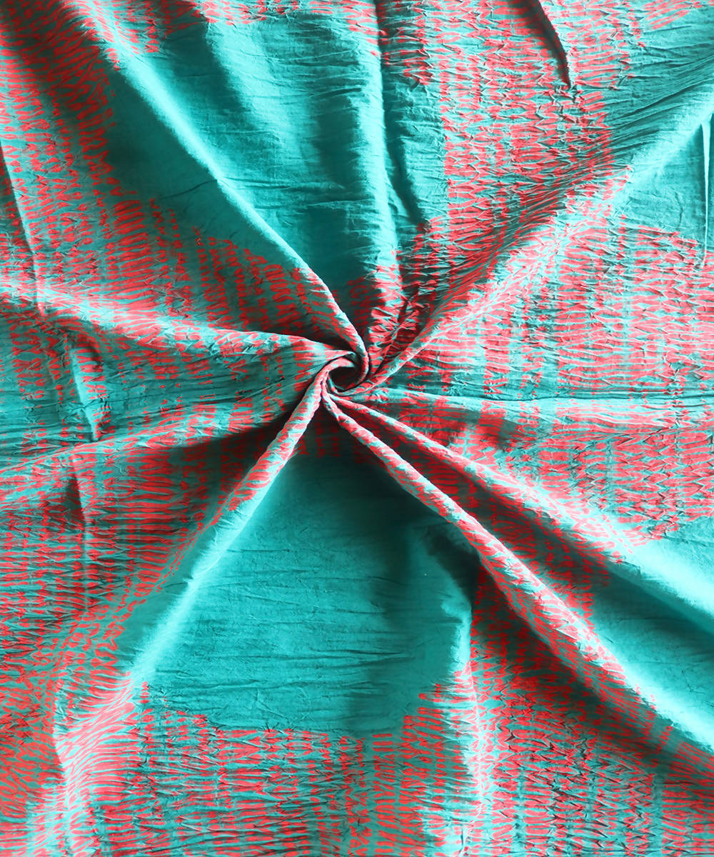 Sea green and red shibori tie dye printed cotton fabric