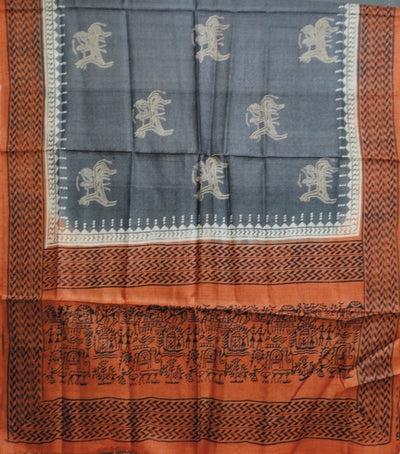 Exclusive Burnt Orange And Arsenic Tussar Tribal printed Dress Material
