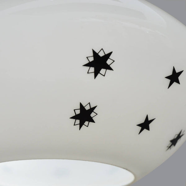 1950s white glass ceiling light with black top and star pattern