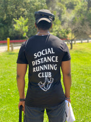 Man stands in Black Social Distance Running T-Shirt