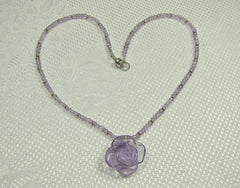 Amethyst Faceted Ball necklace with Tiny Silver Rings and Carved Flower Centre Stone and Silver Magnetic Clasp