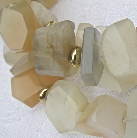 Faceted Nuggets of Moonstone with Gold Buttons and Clasp