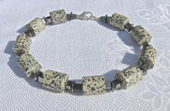 Dalmation Jasper Cylinders with Hematite Squares and Buttons and Silver Clasp