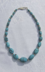 Faceted Turquoise Graded Olives with Silver Buttons in between with silver Clasp