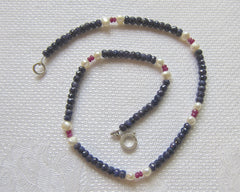 Faceted Sapphire Ball necklace with highlights of Faceted Ruby and Freshwater Pearls on a Silver Clasp