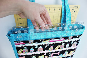 "The outside pockets are large enough for a 12½"" square ruler and a 12""x 18"" cutting mat."