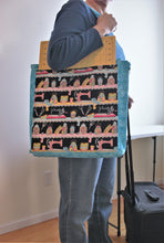 Load image into Gallery viewer, When zipped up, the Sewing Mat Bag forms a tote bag to carry your sewing supplies.