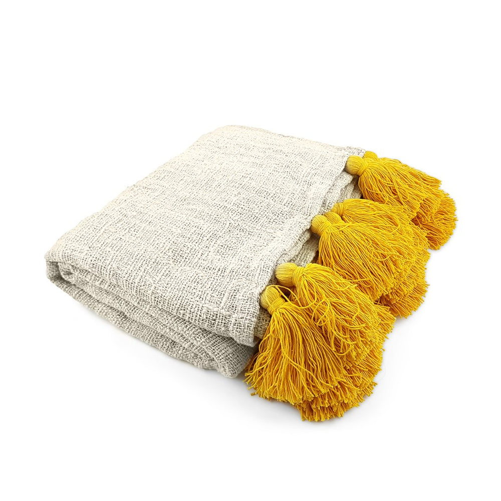Load image into Gallery viewer, Handmade boho Cotton blanket with yellow tassel cream color side view