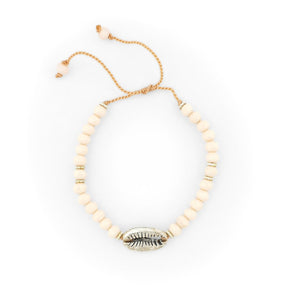 Load image into Gallery viewer, Bracelet with cream crystals and silver brass shell