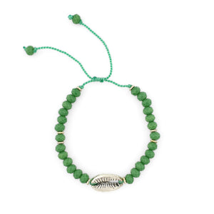 Load image into Gallery viewer, Bracelet with green crystals and silver brass shell