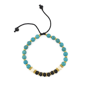 Load image into Gallery viewer, Turquoise Bracelet with gold beads and black crystals