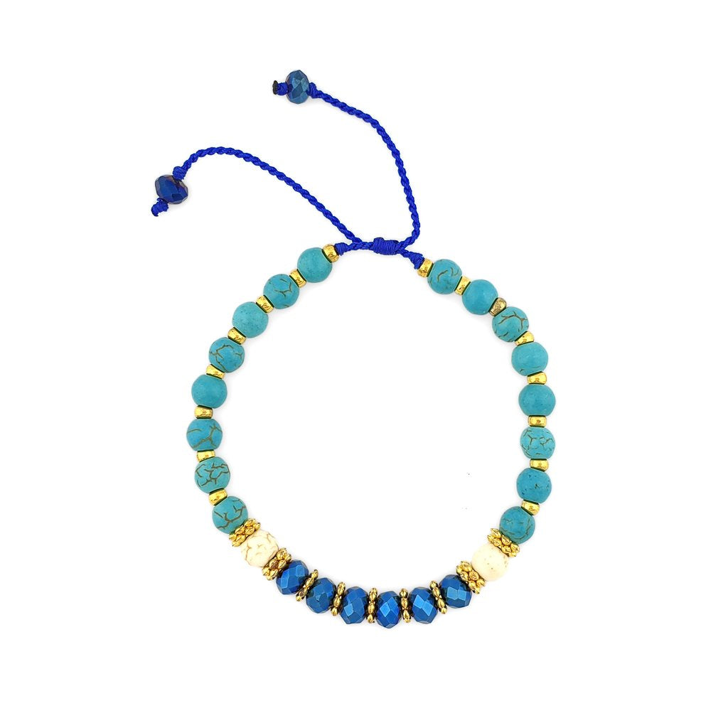 Turquoise Bracelet with gold beads and navy crystals
