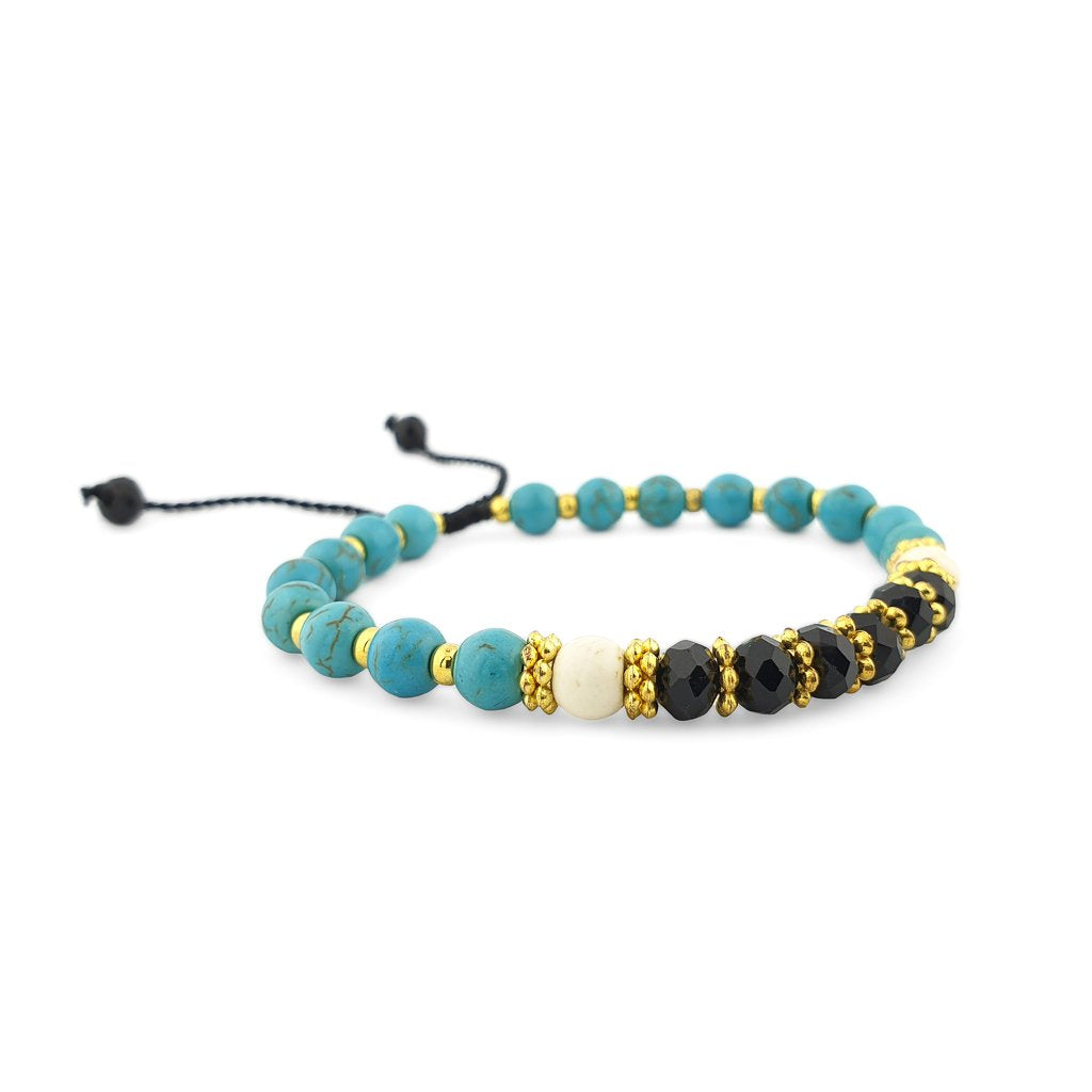 Turquoise Bracelet with gold beads and black crystals side view