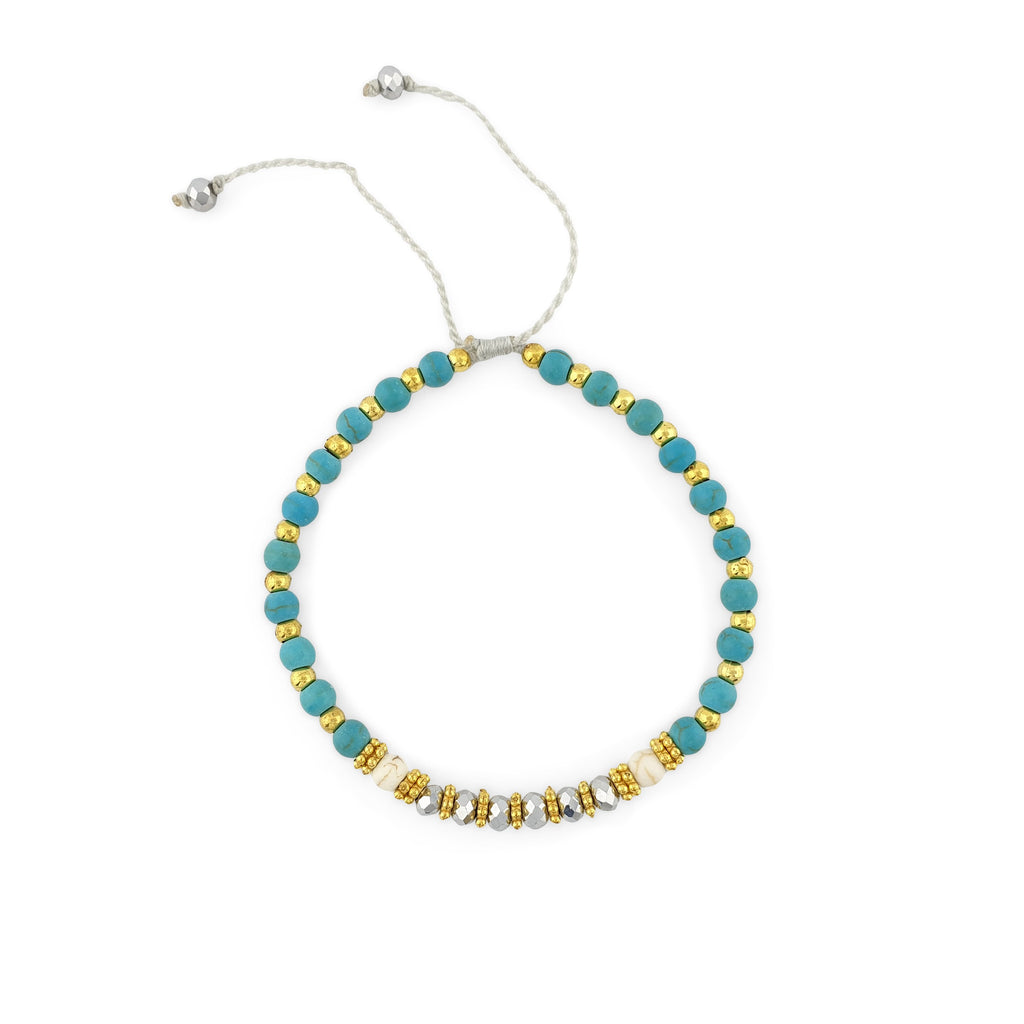 Bracelet with turquoise and gold beads and silver crystal