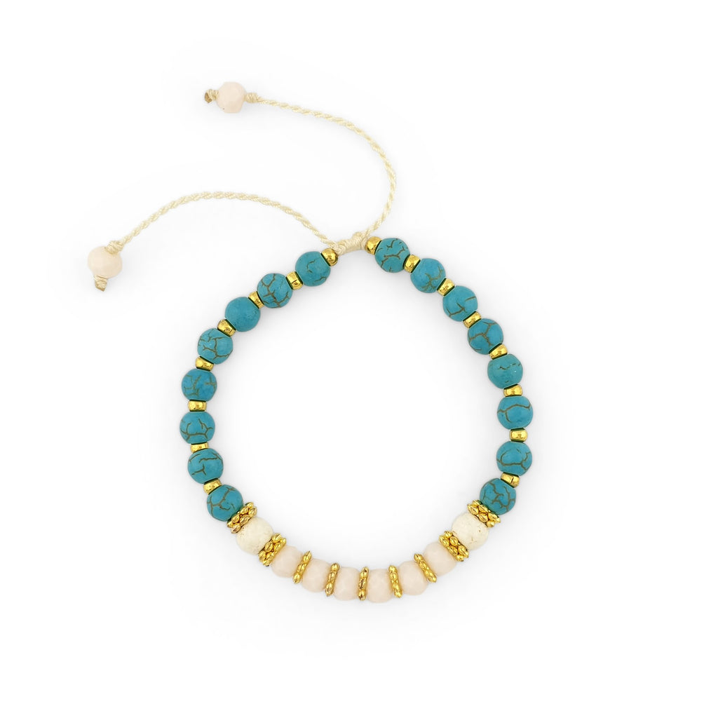 Turquoise Bracelet with gold beads and white crystals