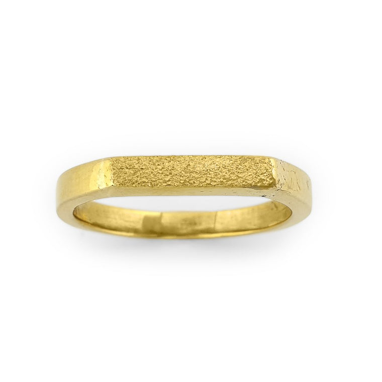 Brass gold color ring with flat and hammered front surface