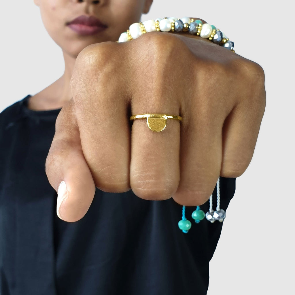 Brass gold color ring with hammered half moon shape on model
