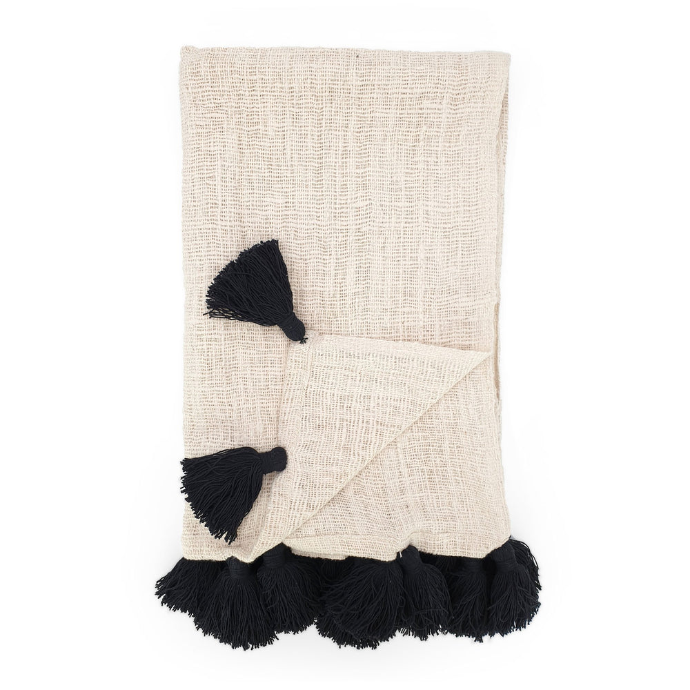 Handmade boho Cotton blanket with black tassel cream color front view