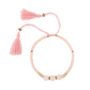 Load image into Gallery viewer, Lucky gemstone bracelet blush pink tassel front view