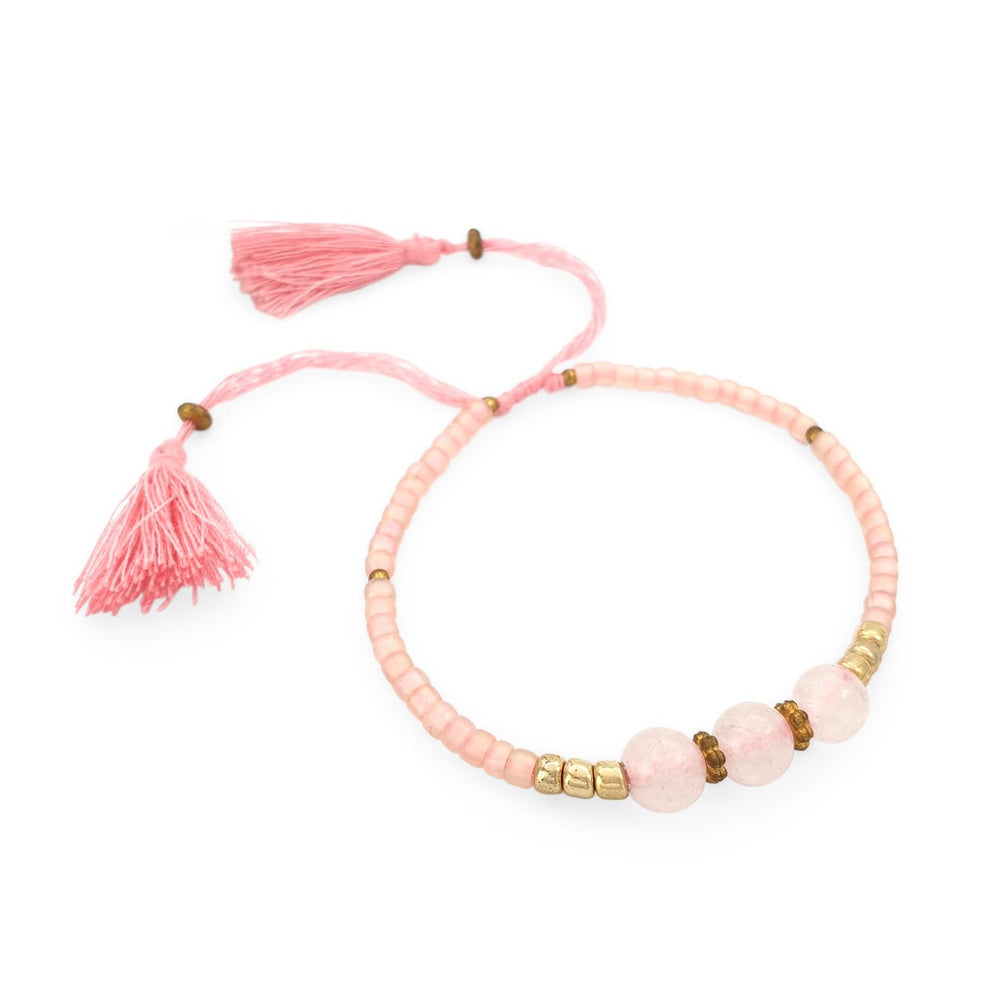 Load image into Gallery viewer, Lucky gemstone bracelet blush pink tassel side view