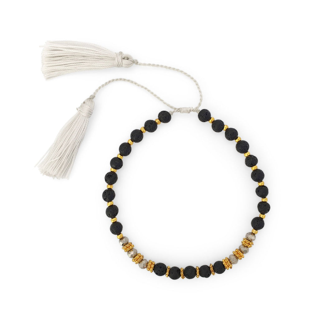 Bracelet lava stone and crystal with white tassel
