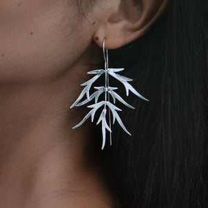Load image into Gallery viewer, Earring Bamboo Leaf silver plated on model