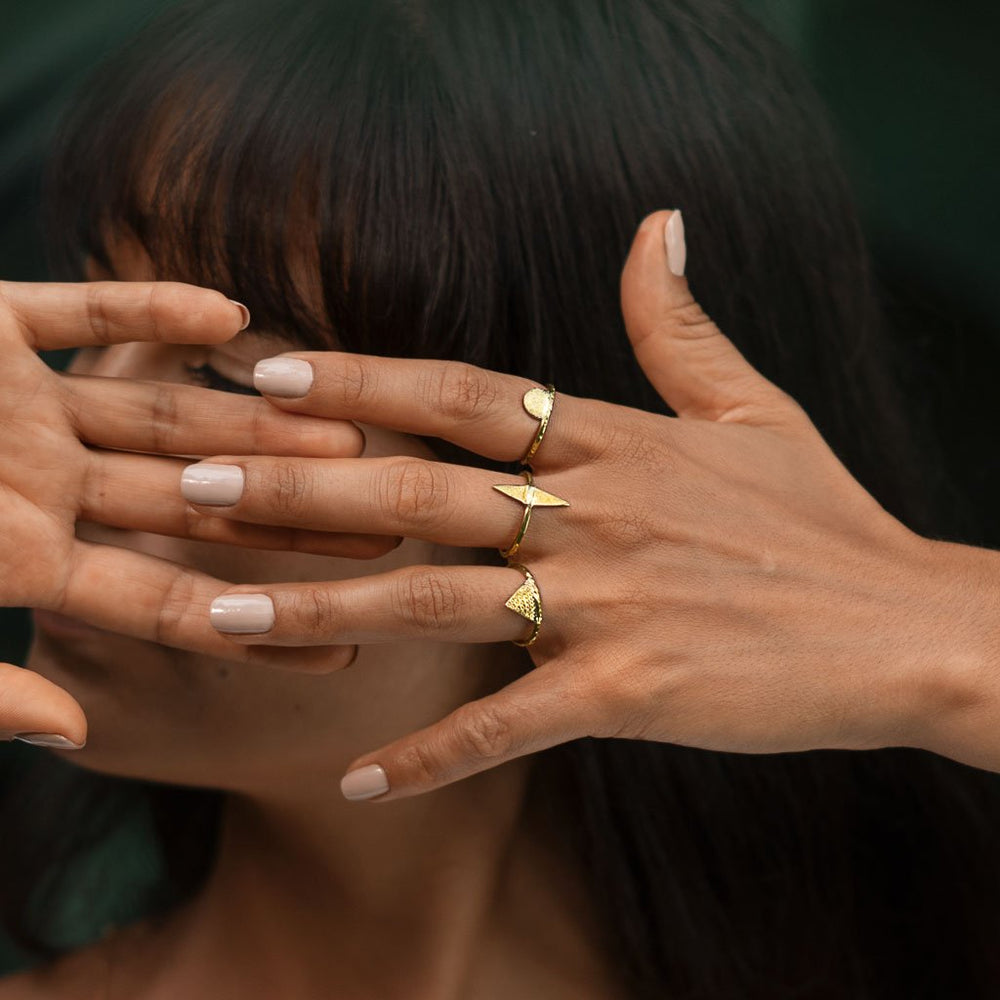 gold geometric rings on model