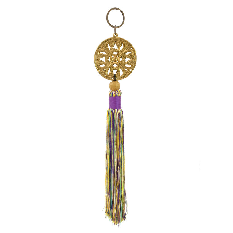Keychain with metal ornament in gold color and mix lilac tassel