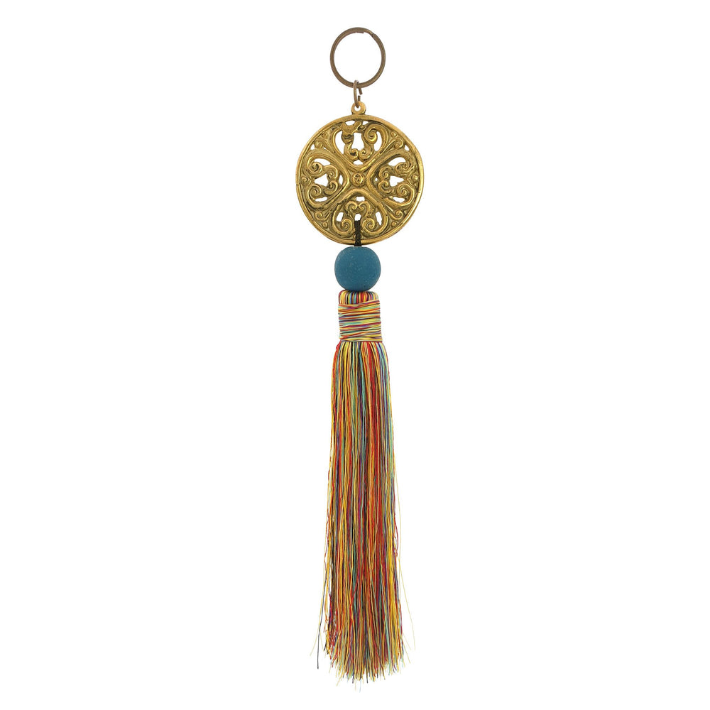Keychain with metal ornament in gold color and mix red tassel