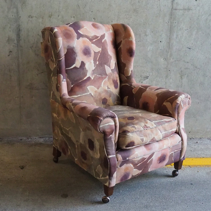 Antique winged armchair recovered in Designers Guild fabric with flowers