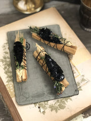 Palo Santo sticks tied together with Rosemary and a arrowhead.