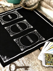 Black tarot cloth with Past, Present and Future written on it.