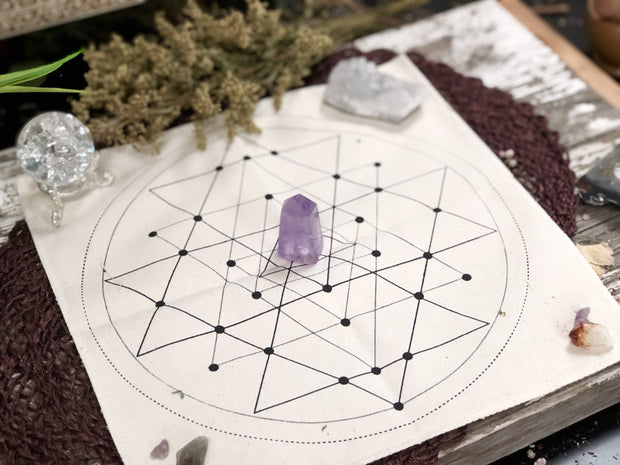 Tan geometric grid cloth with a amethyst tower in the center.