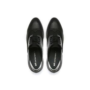 brogue black and marble black top view