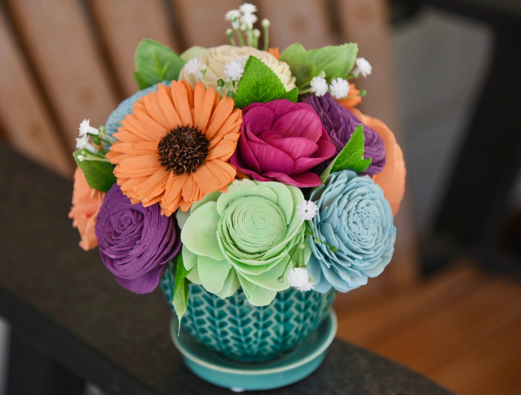 Purples/ Orange/ Blues in a Teal Planter