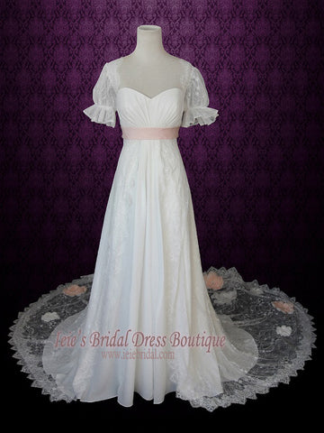 1920s Regency Style Empire Lace Wedding Dress With Sleeves Pink Sash And Peach Blush Flowers