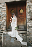 Ieie's vintage style cotton lace mermaid wedding dress with floral sash