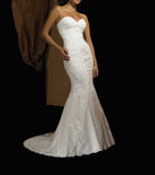Strapless fit and flare lace wedding dress with ruched neckline