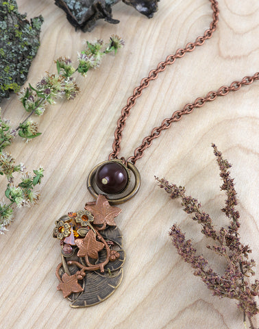 Beautiful charm necklace with folded rivoli in natural autumn colors.