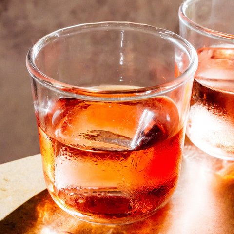 Short drinking glass with red cocktail