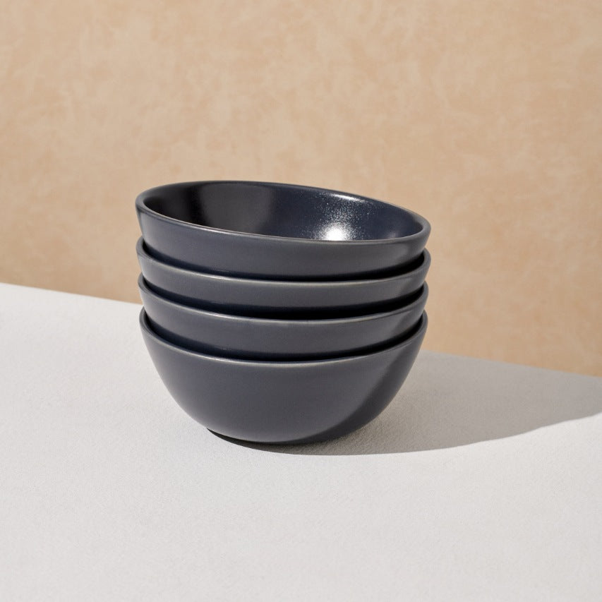 Stack of four charcoal navy breakfast bowls