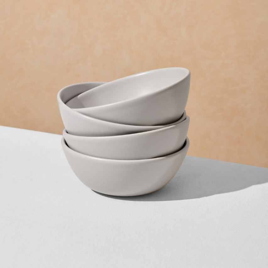 Stack of four grey breakfast bowls