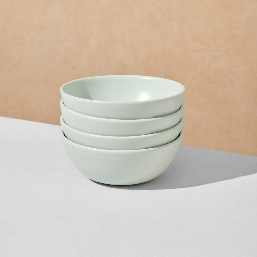 Stack of four mint breakfast bowls