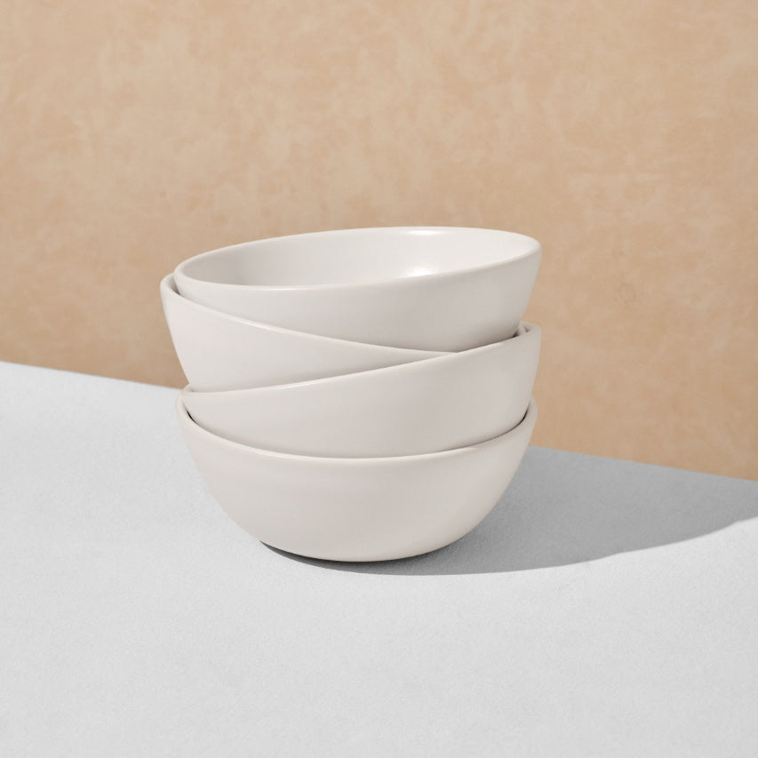 Stack of four off white breakfast bowls