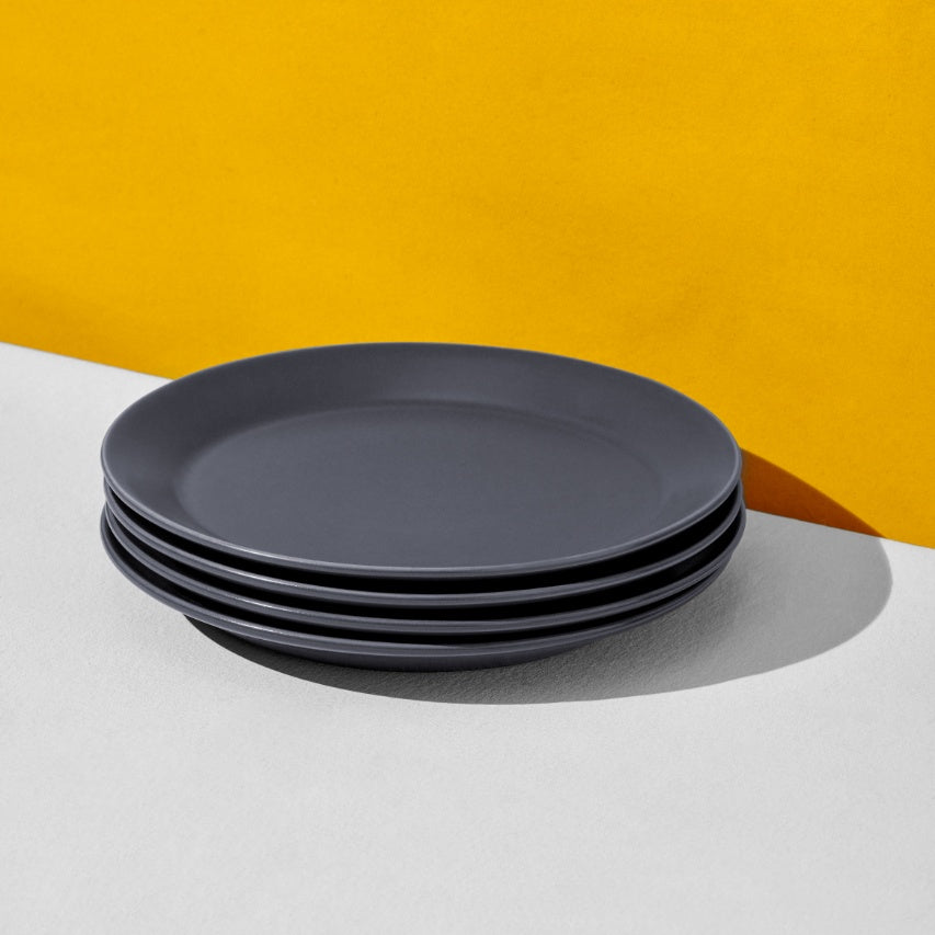 Stack of four charcoal navy dinner plates