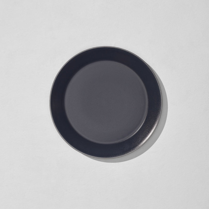 Overhead view of charcoal navy dinner plate