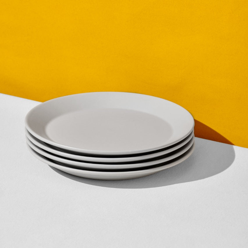 Stack of four grey dinner plates