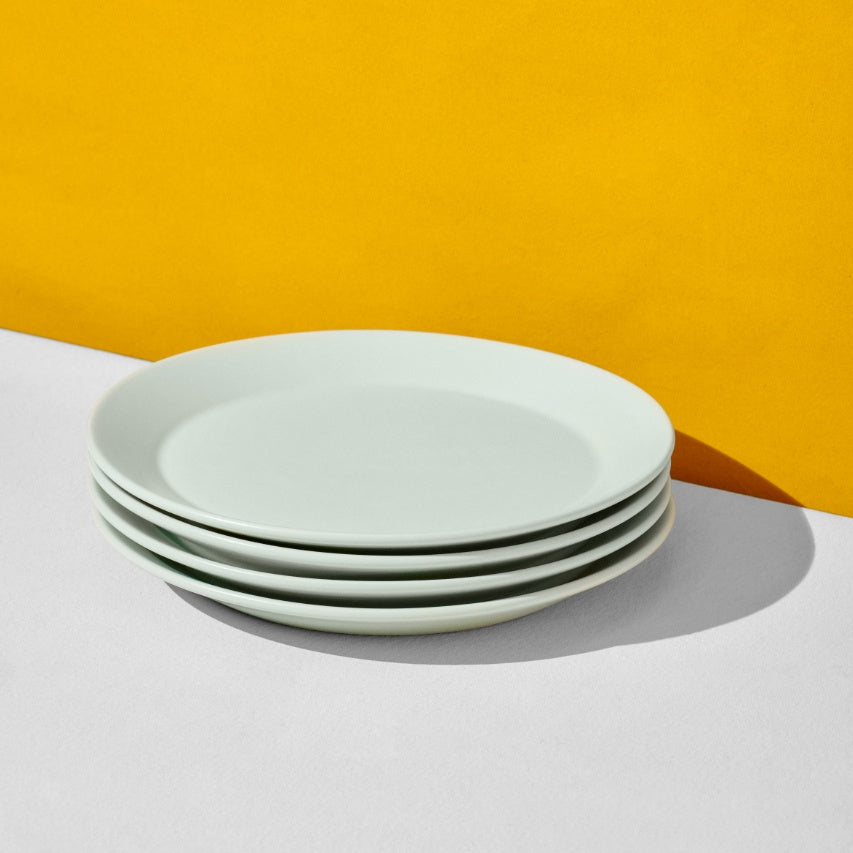 Stack of four mint dinner plates