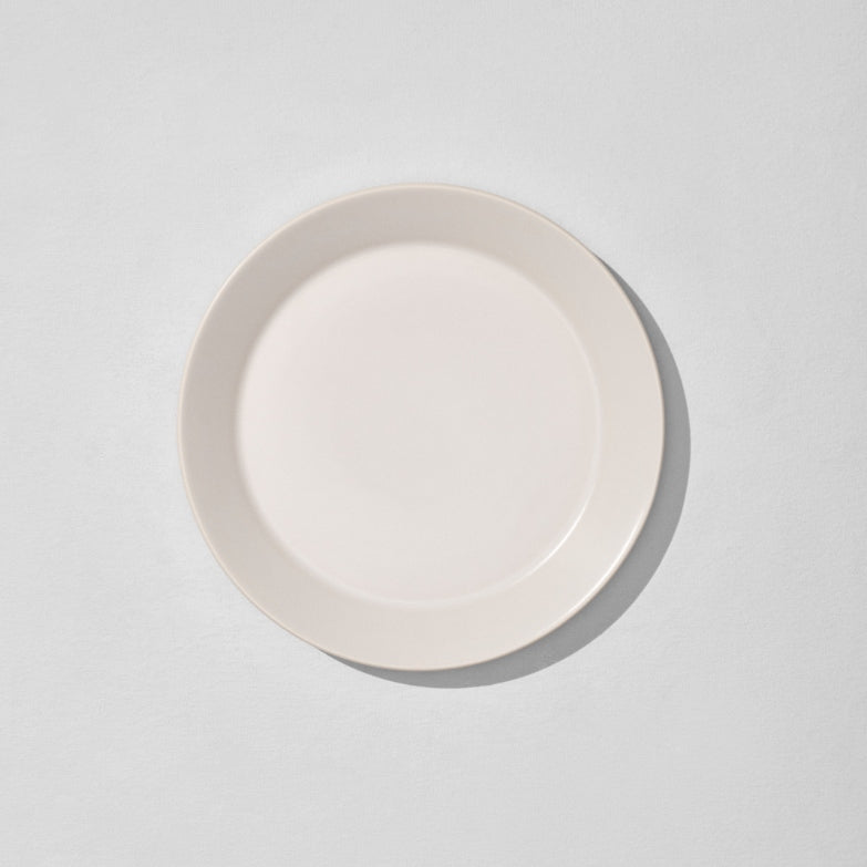Overhead view of off white dinner plate
